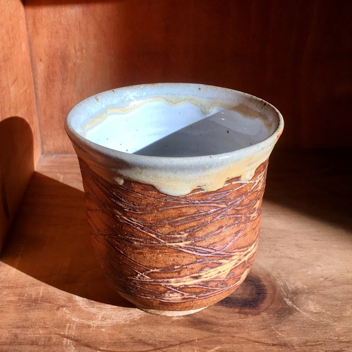 Carved tea cup (Shaner white with scraped-off sunshine yellow)