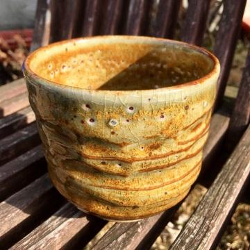 Carved tea bowl (Saint John's yellow over shino) *n/a