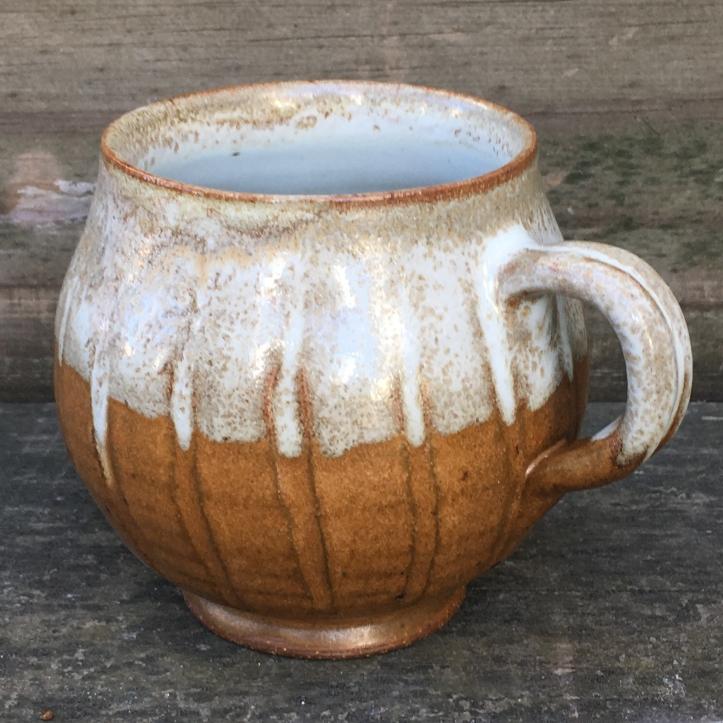 Carved round mug (Shaner white over Anne's orange)