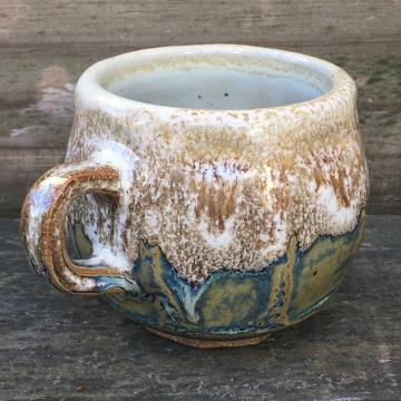Faceted mug (Shaner white over light blue rutile) *n/a
